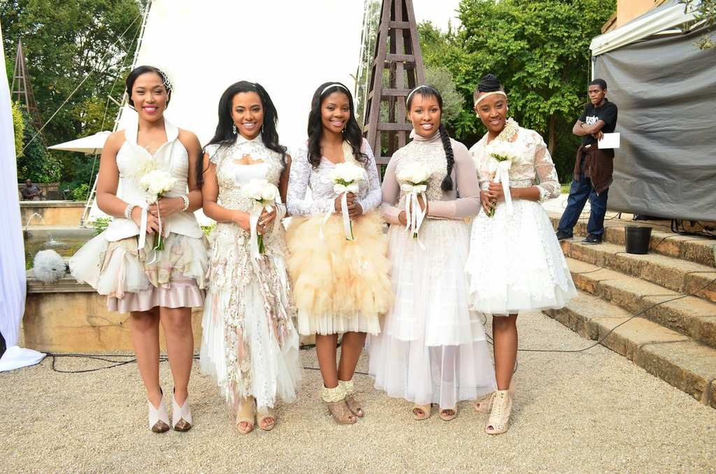4d1e5178f10 These bridesmaid dresses are pretty confusing. They all look like wedding  dresses